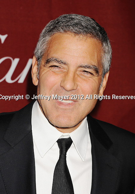 PALM SPRINGS, CA - JANUARY 07: George Clooney arrives at the 2012 Palm Springs Film Festival Awards Gala at the Palm Springs Convention Center on January 7, 2012 in Palm Springs, California.