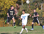 BEACON FALLS  CT. - 15 October 2019-101519SV13- #13 Jack Schwarz of Woodland High heads ball past #7 Matt Darroch of Oxford High during NVL soccer action in Beacon Falls Tuesday. #16 George Hughes of Woodland High, at right. <br />Steven Valenti Republican-American
