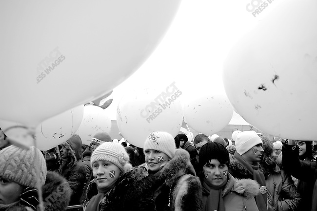 At a meeting of the pro-Kremlin youth organisation Nashi aimed at bringing out the vote for United Russia and aimed in particular against the opposition group Other Russia, members stood in line, some with faces painted with a tick next to the name of Putin and the flag of Nashi. Moscow, Russia, November 19, 2007