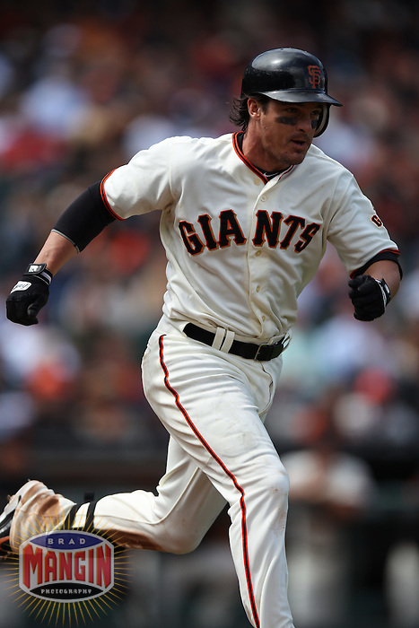 SAN FRANCISCO, CA - JUNE 4:  Ryan Theriot #5 of the San Francisco Giants runs to first base against the Chicago Cubs during the game at AT&T Park on Monday, June 4, 2012 in San Francisco, California. Photo by Brad Mangin