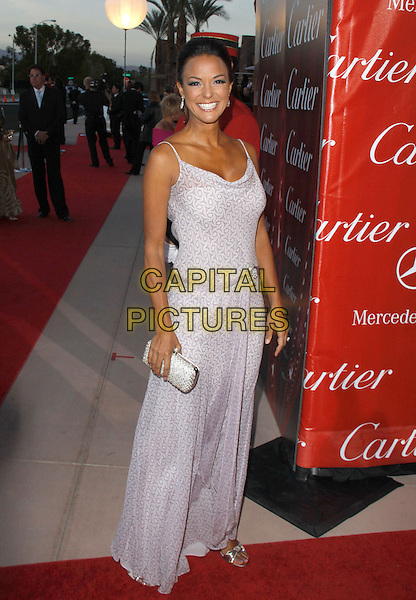 EVA LaRUE.The 21st Annual Palm Springs International Film Festival held at The Civic Center in Palm Springs, California, USA. .January 5th, 2010.full length purple dress lilac pattern maxi la rue silver clutch bag .CAP/RKE/DVS.©DVS/RockinExposures/Capital Pictures.