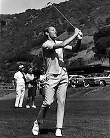 Warrior basketball star Rick Barry playing golf.<br />