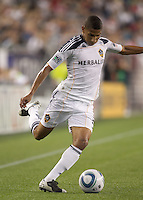 Los Angeles Galaxy defender Sean Franklin (5) passes the ball. In a Major League Soccer (MLS) match, the Los Angeles Galaxy defeated the New England Revolution, 1-0, at Gillette Stadium on May 28, 2011.