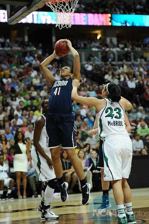 01 APRIL 2012:  Center Kiah Stokes of UCONN (41) takes a shot against Notre Dame during the Division I Women's Final Four semifinals at the Pepsi Center in Denver, CO.  Stephen Nowland/NCAA Photos