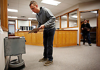 NWA Media/DAVID GOTTSCHALK - 12/8/14 - Brandon Bullette (cq) casts a paper ballot Monday December 8, 2014 at the Washington County Clerk and Probate office in the Washington County Courthouse on the last day of early voting. Seventeen polling sites are open today in  Fayetteville for the special election concerning the Civil Rights Administration ordinance. Voting is available at the polling sites and not the Washington County Courthouse today.