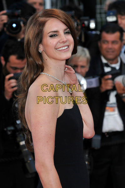 Lana Del Rey.'Moonrise Kingdom' screening and opening of the 65th Cannes Film Festival, France..16th May 2012.half length black strapless  diamond necklace hand side smiling .CAP/PL.©Phil Loftus/Capital Pictures.