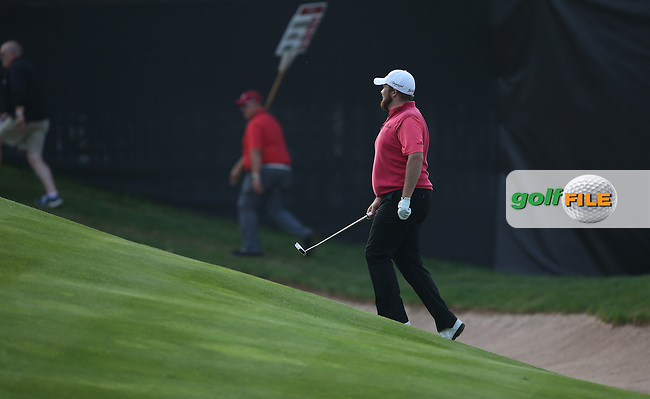 Shane Lowry (IRL) climbs onto the last during Round Three of the ISPS Handa Wales Open 2014 from the Celtic Manor Resort, Newport, South Wales. Picture:  David Lloyd / www.golffile.ie