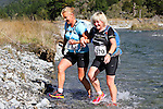 NELSON LAKES, NEW ZEALAND - APRIL 18: Helen Flannery and Carolyn Vasta cross the Travers River during the 2015 Alpine Lodge Loop The Lake trail run at Lake Rotoiti on April 18 16, 2015 in Nelson, New Zealand. (Photo by Marc Palmano/Shuttersport Limited)