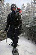 Hiker on Mount Tecumseh Trail during the winter months. Mount Tecumseh Trail leads to Mount Tecumseh in the White Mountains, New Hampshire.