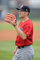 Left field Max Murphy (13) of the Elizabethton Twins warms up before a game against the Johnson City Cardinals on Sunday, July 27, 2014, at Howard Johnson Field at Cardinal Park in Johnson City, Tennessee. The game was suspended due to weather in the fifth inning. (Tom Priddy/Four Seam Images)