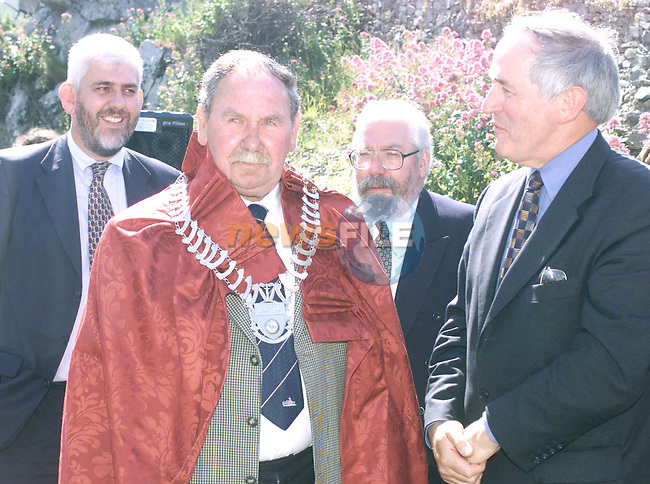 "King John......Past Chairman of Louth County Council John McConville gets the ""Royal Treatment"" from present Chairman Peter Savage watched by Dermot Brangan, (Left) Director General IFI and William McCarter, Chairman IFI at the official opening of the Port Oriel Harbour and Clogherhead Pier Improvements and New Facilities."