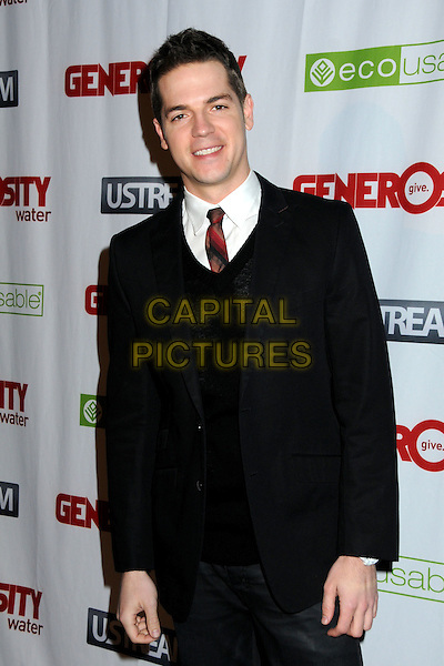 JASON KENNEDY .Generosity Water's 2nd Annual Night of Generosity held at the Mondrian Hotel's Skybar, West Hollywood, California , USA, 22nd March 2010..half length black suit red tie white shirt .CAP/ADM/BP.©Byron Purvis/AdMedia/Capital Pictures.