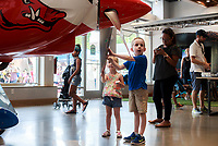 NWA Democrat-Gazette/CHARLIE KAIJO Will Kingsley, 6 of Bentonville reacts while looking at a XA42 airplane, Friday, July 6, 2018 at the OZ1 Flying Club pop-up shop in Bentonville. <br />