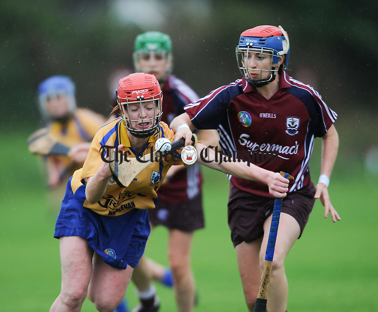 Deirdre Murphy of Clare in action against Sandra Tannion of Galway during the Gala All-Ireland senior championship game at Corofin. Photograph by John Kelly.