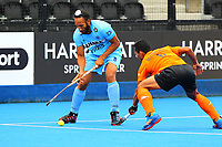 Surender Kumar of India competes with Marhan Jalil of Malaysia during the Hockey World League Quarter-Final match between India and Malaysia at the Olympic Park, London, England on 22 June 2017. Photo by Steve McCarthy.