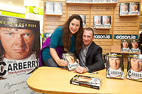 NO REPRO FEE.8/10/2011. Eason, Ireland's leading retailer of books, stationery, magazines and lots more, hosted a book signing by Jockey, Paul Carberry.  Pictured at Eason, O'Connell Street, Dublin is fan Breda Hegarty from Cork with Paul Carberry who signed copies of his new autobiography One Hell of a Ride. Follow Eason on Twitter - @easons For further information, please contact: Aoife McDonald WHPR 087 4100777 . Picture James Horan/Collins Photos