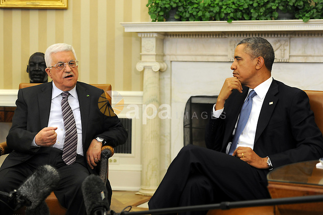 President Barack Obama (R) meets with Palestinian President Mahmoud Abbas (L) in the Oval Office of the White House in Washington, DC, USA, 17 March 2014. Obama meets Abbas after telling Israeli Prime Minister Benjamin Netanyahu in an Oval Office meeting on March 3 that tough decisions are looming ahead of an end of April deadline to agree on a framework for future negotiations for peace talks. Photo by Thaer Ganaim