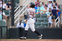 Tyler Sullivan (12) of the Kannapolis Intimidators follows through on his swing against the Delmarva Shorebirds at Kannapolis Intimidators Stadium on July 3, 2017 in Kannapolis, North Carolina.  The Shorebirds defeated the Intimidators 5-2.  (Brian Westerholt/Four Seam Images)
