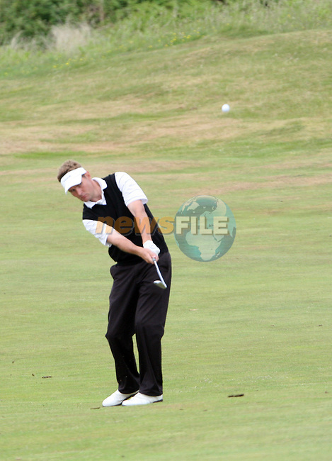 James Fox of Portmarnock Golf Club hitting onto the 3rd green on day 2 of the 2010 East of Ireland Amateur Golf Competition in Co.Louth Golf Club...Photo NEWSFILE/Jenny Matthews.(Photo credit should read Jenny Matthews/NEWSFILE)....This Picture has been sent you under the condtions enclosed by:.Newsfile Ltd..The Studio,.Millmount Abbey,.Drogheda,.Co Meath..Ireland..Tel: +353(0)41-9871240.Fax: +353(0)41-9871260.GSM: +353(0)86-2500958.email: pictures@newsfile.ie.www.newsfile.ie.FTP: 193.120.102.198.