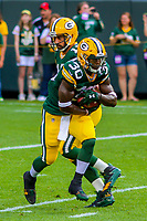 Green Bay Packers running back Jamaal Williams (30) and quarterback Aaron Rodgers (12) during a preseason football game against the Philadelphia Eagles on August 10, 2017 at Lambeau Field in Green Bay, Wisconsin. Green Bay defeated Philadelphia 24-9.  (Brad Krause/Krause Sports Photography)