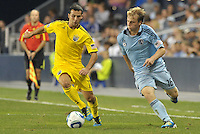 Columbus Crew midfielder Dilly Duka (11) gets ahead of Sporting KC defender Seth Sinovic (16)... Sporting Kansas City defeat Columbus Crew 2-1 at LIVESTRONG Sporting Park, Kansas City, Kansas.