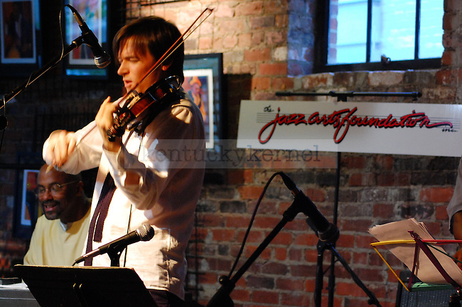 Zach Brock (left), a nationally known violinist and Lexington native, plays jazz music during the 20th anniversary Jazz Arts Foundation Birthday Bash at Natasha's Cafe in downtown Lexington on Sunday April 25.  Photo by Brandon Goodwin | Staff