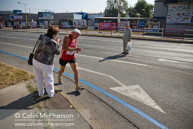A woman encouraging a participant during the annual Peace Marathon in the city of Kosice, in the Slovak Republic. The city, which lies in eastern Slovakia is the country's second largest after Bratislava and has been announced as European Capital of Culture in 2013, along with Marseille, France. Kosice was the seat of the Kosice Region, home to the Slovak Constitutional Court, three universities and many museums, galleries and theaters as well as an important industrial center.