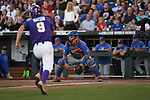 OMAHA, NE - JUNE 26: Zach Watson (9) of Louisiana State University runs towards home plate and Mike Rivera (4) of the University of Florida during the Division I Men's Baseball Championship held at TD Ameritrade Park on June 26, 2017 in Omaha, Nebraska. The University of Florida defeated Louisiana State University 4-3 in game one of the best of three series. (Photo by Justin Tafoya/NCAA Photos via Getty Images)
