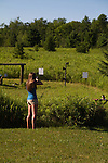 Young woman shooting at targets