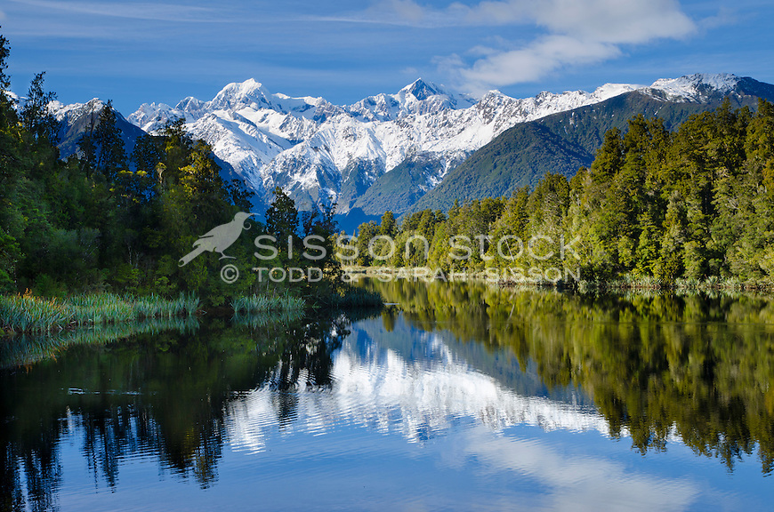 Mount Cook and Mount Tasman reflected in Lake Matheson, South Westland, New Zealand