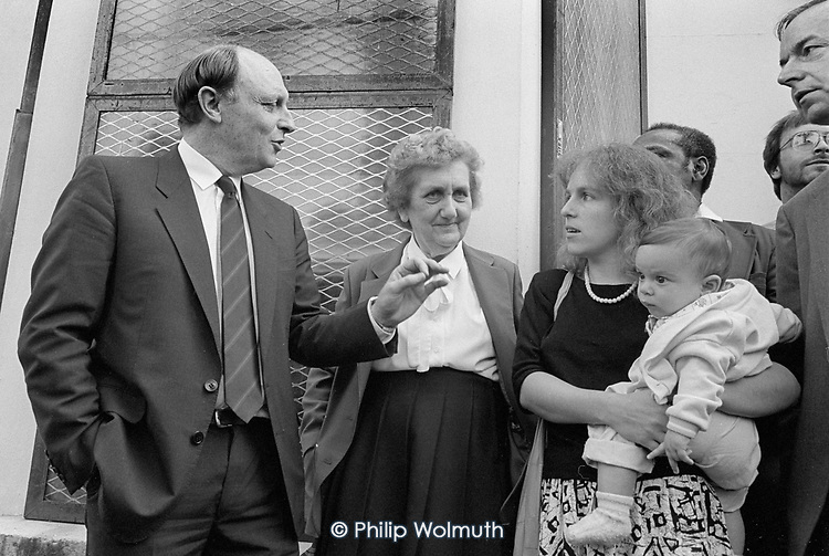 Labour Party leader Neil Kinnock with Irene Blackman and Jackie Rosenberg on a tour of Walterton and Elgin Estates in support of the resident-led campaign to take control of their homes from Westminster City Council.  North Paddington, London 1988.