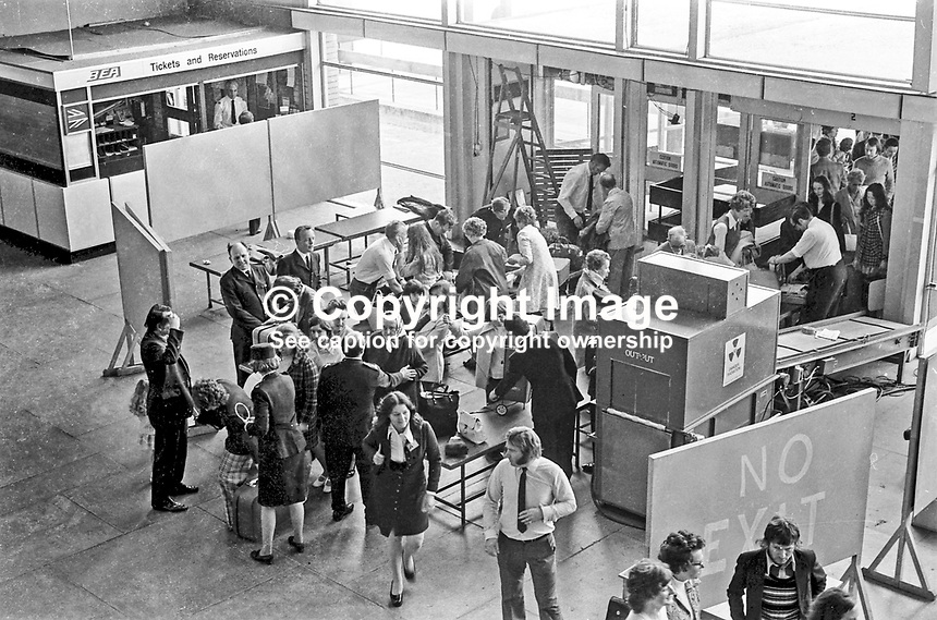 Belfast International Airport, Aldergrove, Co Antrim, N Ireland - airport security check in 1973 in terminal building following recent IRA attacks. LH 497/73, 197300000497.<br /> <br /> Copyright Image from Victor Patterson, 54 Dorchester Park, Belfast, UK, BT9 6RJ<br /> <br /> t1: +44 28 9066 1296 (from Rep of Ireland 048 9066 1296)<br /> t2: +44 28 9002 2446 (from Rep of Ireland 048 9002 2446)<br /> m: +44 7802 353836<br /> <br /> e1: victorpatterson@me.com<br /> e2: victorpatterson@gmail.com<br /> <br /> The use of my copyright images is subject to my Terms &amp; Conditions.<br /> <br /> It is IMPORTANT that you familiarise yourself with them. They are available on my website at www.victorpatterson.com.<br /> <br /> None of my copyright images may be used on a website or on television unless they are visibly watermarked, i.e. &copy; Victor Patterson within the body of the visible image. The metadata of images used on the Internet must not be removed.<br /> <br /> Copyright acknowledgment of my images is a condition of use.<br /> <br /> Failure to observe the above conditions will incur a penalty of at least 100% of the agreed fee. <br /> <br /> Web use (maximum size - 400 kb) is extra at currently recommended NUJ rates.