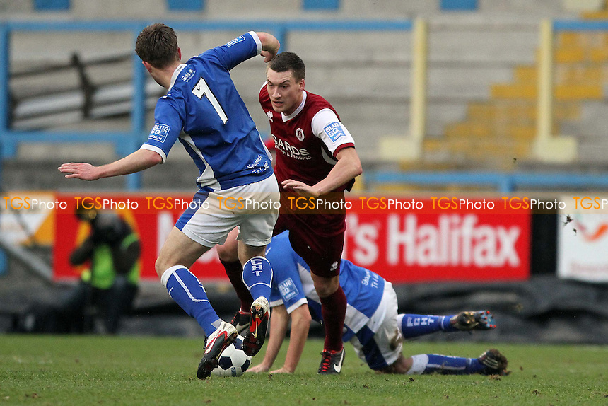 Chris Worsley (Halifax Town) and Max Cornhill (Chelmsford City) go for the ball. - FC Halifax Town vs Chelmsford City - FA Challenge Trophy 3rd Round Football at the Shay Stadium, Halifax - 12/01/13 - MANDATORY CREDIT: Mick Kearns/TGSPHOTO - Self billing applies where appropriate - 0845 094 6026 - contact@tgsphoto.co.uk - NO UNPAID USE.