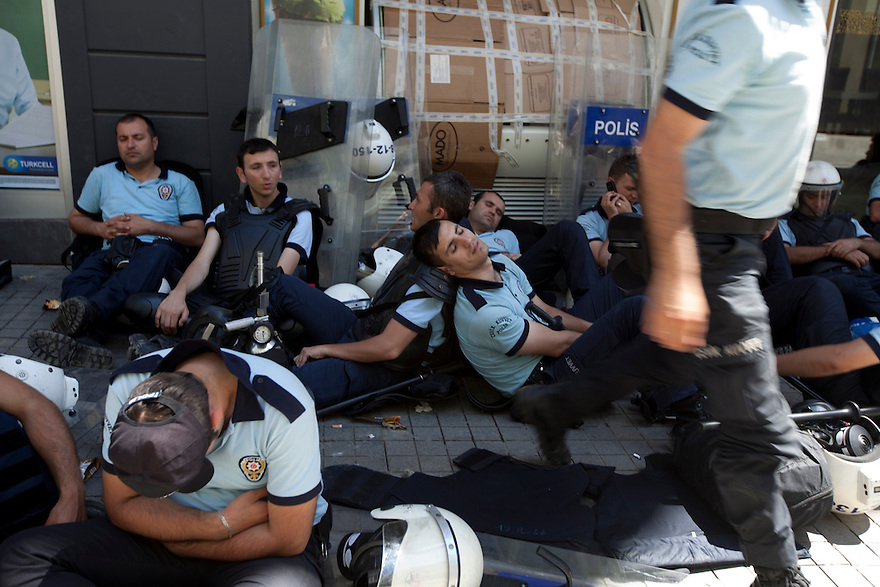 ISTANBUL, TURKEY-- Police rest at midday on Saturday, June 1, 2013 on Istiklal Street near Taksim Square, where protesters and police have clashed over recent days. Protests were sparked when bulldozers removed trees in Gezi Park, the site where a new mall is planned for central Istanbul. PHOTO BY JODI HILTON