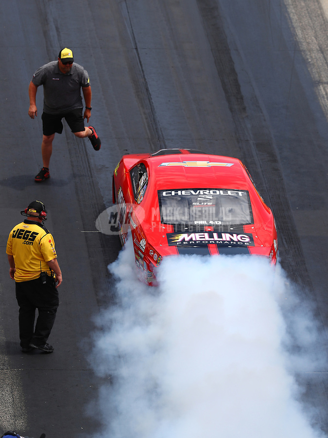 Jul 9, 2017; Joliet, IL, USA; NHRA pro stock driver Erica Enders-Stevens does a burnout past team owner Richard Freeman during the Route 66 Nationals at Route 66 Raceway. Mandatory Credit: Mark J. Rebilas-USA TODAY Sports