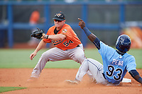 Baltimore Orioles Cadyn Grenier (54) receives a throw from the catcher as Tony Pena (93) slides into second base during a Florida Instructional League game against the Tampa Bay Rays on October 1, 2018 at the Charlotte Sports Park in Port Charlotte, Florida.  (Mike Janes/Four Seam Images)