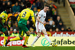 John Lundstram (r) of Sheffield United runs at Mario Vrancic of Norwich City during the Premier League match at Carrow Road, Norwich. Picture date: 8th December 2019. Picture credit should read: James Wilson/Sportimage