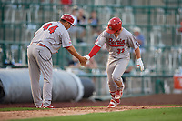 Peoria Chiefs manager Erick Almonte (44) congratulates Brendan Donovan (33) after hitting a home run during a Midwest League game against the Fort Wayne TinCaps on July 17, 2019 at Parkview Field in Fort Wayne, Indiana.  Fort Wayne defeated Peoria 6-2.  (Mike Janes/Four Seam Images)