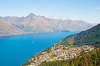 An Aerial Photo of Queenstown, Lake Wakatipu and the Remarkables Mountains, South Island, New Zealand. From the centre of Queenstown, catching a gondola ride into the mountains provides unrivalled views over the entirity of Queenstown and Lake Wakatipu, with the Remarkables Mountain Range providing a perfect backdrop.
