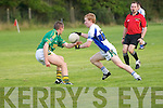 Castleisland Desmond's Thomas Hickey gets the ball away depite the close presence of Finuges John Griffin at the Division 2 game  played in Finuge on Saturday evening last.
