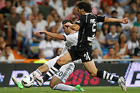 02.09.2012 SPAIN -  La Liga 12/13 Matchday 3th  match played between Real Madrid CF vs  Granada C.F. (3-0) at Santiago Bernabeu stadium. The picture show Gonzalo Higuain (Argentine/French Forward of Real Madrid) and Diego Mainz Garcia (Spanish Defender of Granada C.F.)