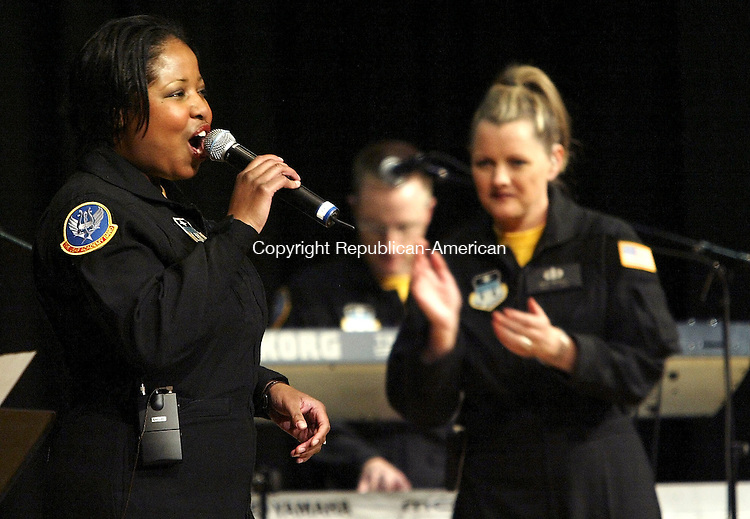 WATERBURY, CT- 11 APRIL 2005-041105J05--Master Sergeant Cassandra L. Anderson, left, sings during Monday nights performance of The United States Air Force Band 'Blue Steet' at Kennedy High School in Waterbury. In the background is Technical Sergeant Andrew J. Benton, center, on piano and Technical Sergeant Julie A. Bradley, right, on vocals  --- Jim Shannon Photo--Master Sergeant Cassandra L. Anderson; The United States Air Force; Blue Steel; Kennedy High School; Waterbury; Technical Sergeant Andrew J. Benton; Technical Sergeant Julie A. Bradley are CQ