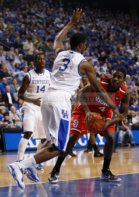 Terrence Jones guards Moe Harkless in the game against St. Johns University at Rupp Arena, in Lexington, Ky., on Thursday, Dec. 1, 2011. Photo by Latara Appleby | Staff ..