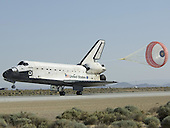 Edwards, CA - May 24, 2009 -- Space Shuttle Atlantis trails its drag parachute to slow it down as it rolls out on Runway 22 after landing Sunday morning at Edwards Air Force Base. .Mandatory Credit: Carla Thomas - NASA via CNP