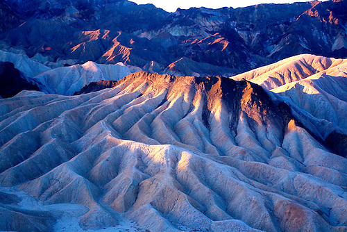 THE BADLANDS OF DEATH VALLEY JUST AFTER SUNRISE FROM ZABRISKE POINT IN DEATH VALLEY NATIONAL PARK