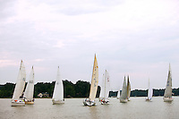 Photography of Lake Norman's Outrigger Yacht Club (OYC), an organization of sailing enthusiasts dedicated to promoting seamanship, friendly competition and social activities for sailors on Lake Norman, a man-made lake located north of Charlotte, NC. Outrigger Yacht Club members hold weekly racing events during the summer months, as well as lake-wide regattas and open events. Photos were created during one of the PYC's Wednesday Night Series racing events in July 2009.
