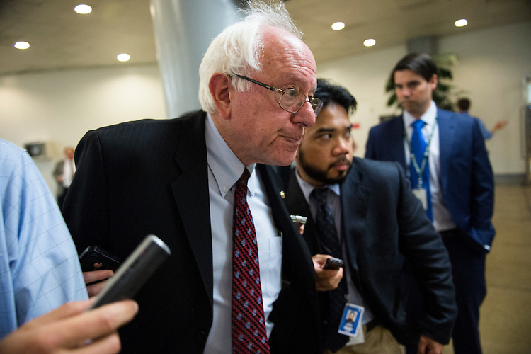 UNITED STATES - JUNE 11: Sen. Bernie Sanders, I-Vt., speaks with reporters as he makes his way from the Senate subway to the Capitol for the weekly policy lunch on Tuesday, June 11, 2013.  (Photo By Bill Clark/CQ Roll Call)