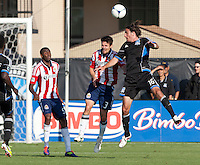 Santa Clara, California - Sunday May 13th, 2012: Heath Pearce of Chivas USA defending Alan Gordon of San Jose Earthquakes during a Major League Soccer match at Buck Shaw Stadium