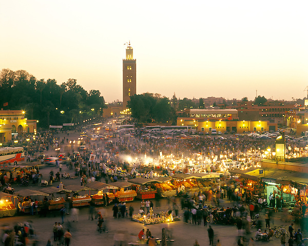 MARRAKECH, MOROCCO: A view of food stalls in the marketplace and public square Place Jema al Fna in Marrakech during dusk. Marrakech, Morocco, North Africa.