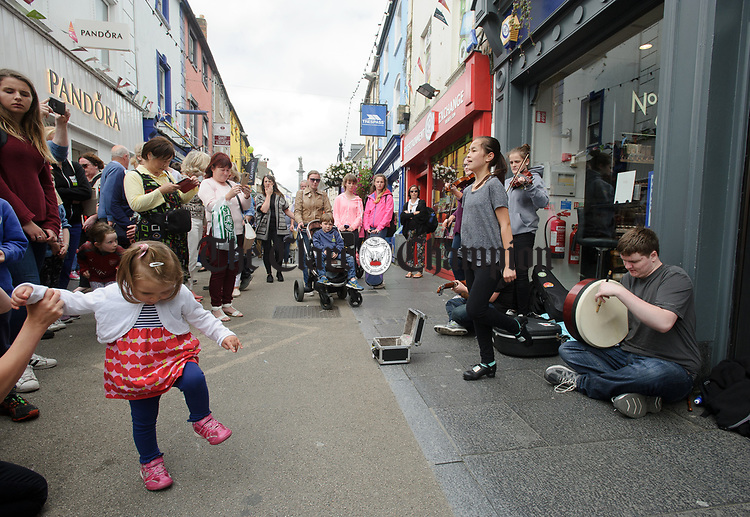 Niamh Serd dancing with Liam Godley on bodhran performing on O Connell street during Fleadh Cheoil na hEireann in Ennis. Photograph by John Kelly.